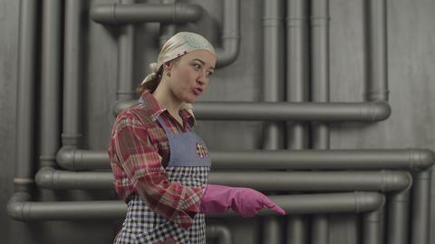 Strict housewife demonstrating warning gesture Footage