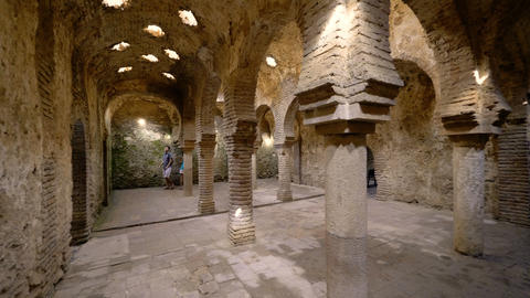 Ronda, Spain, Circa July 2018. Tourists visiting the interior of the arabic baths Footage