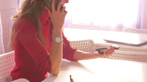 close view woman in red clothing speaks on smartphone GIF