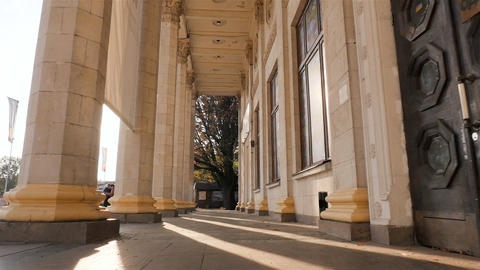 Beautiful columns. Camera in motion. High building. Sun rays. Slow motion Footage