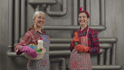 Two housekeepers women ready to clean up house GIF