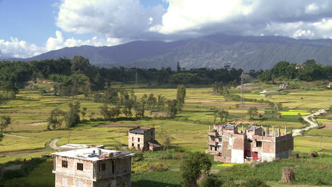 Landscape of farm with patches of homes in Nepal Footage