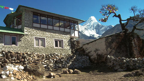 Teahouse with flags near Ama Dablam in the Himalayas Footage