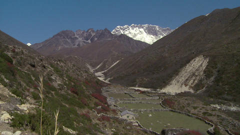 Stone wall fences in a valley in the Himalayas of Nepal Footage