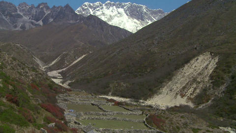 Tilt from Mount Everest to a valley below Footage