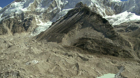Prominent Himalayan peak and a glacier flowing down through a valley Footage