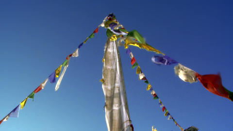 Buddhist prayer flags on a pole waving in the breeze Footage