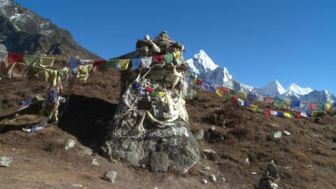 Monument with Buddhist prayer flags in the Himalayas Footage
