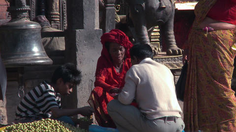 Man bartering in village marketplace in Nepal Footage