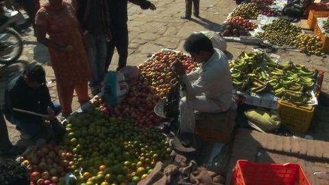Woman buying apples in a market in Nepal Footage