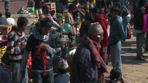 People at a market in a village in Nepal Footage