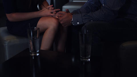 Slow tilt shot of a couple talking to each other Footage