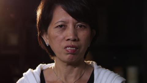 Close-up shot of an elderly asian woman Footage