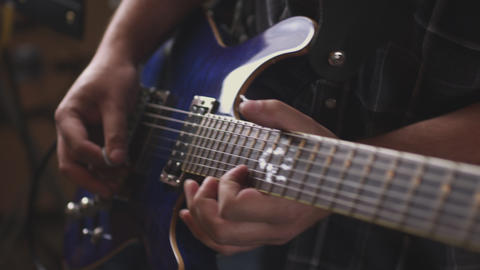Handheld A musician strums his guitar Footage