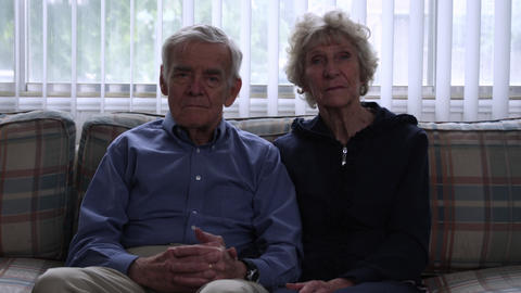 Static shot of a senior couple in a living room Footage