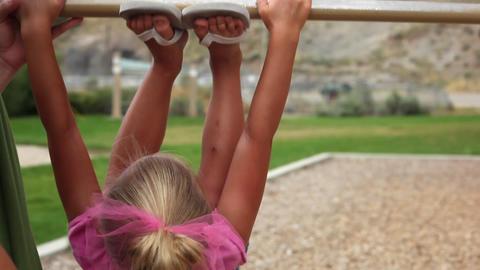 Handheld shot of a little girl doing a flip Footage