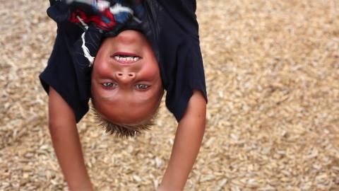 Static closeup shot of an upside down boy Footage