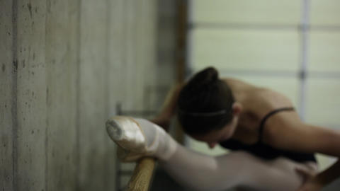 Rack-fodus shot of a dancer exercising on a ballet barre Footage