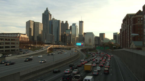 A static shot of traffic building up on the freeway near the Atlanta Skyline in  Footage