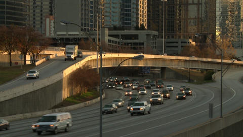 A static shot of cars driving under a bridge in Atlanta, Georgia near the Atlant Footage