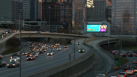 Panning shot from left to right of the Atlanta Skyline and the traffic below dur Footage