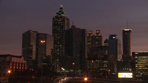Panning, medium shot from left to right of the Atlanta Skyline at night with ill Footage
