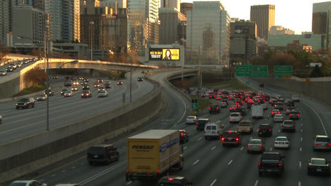 Tilting upward shot from traffic to the Atlanta Skyline during dusk Footage