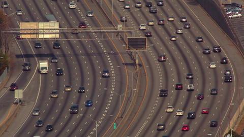 A static, medium shot of flowing cars on the freeway in Atlanta, Georgia Footage