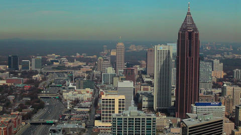 A static, high, wide shot of the Atlanta Skyline with the tip of a building show Footage