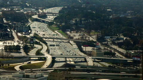 A high angle, static, wide shot of cars flowing on the freeway in Atlanta, Georg Footage