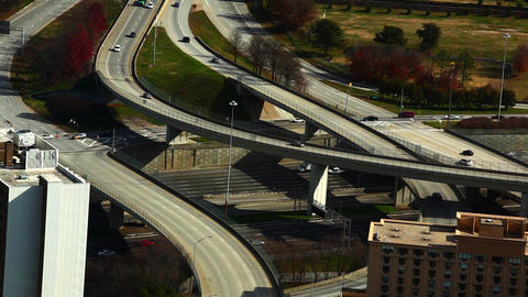 A static shot of cars flowing on the freeway under bridges Footage