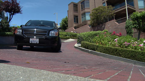 View of a car driving the sharp turns on Lombard Street in San Francisco Footage