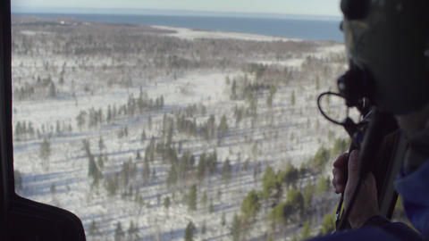 Point of view from pilot of a helicopter flying over the forest of Siberia Live Action