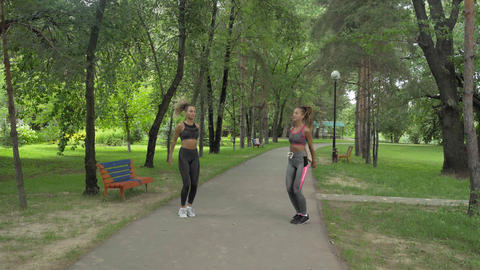 Sportswomen Wearing Sportswear Doing Squats Exercise Outdoors. Fitness Female Footage