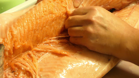 Female Hands Extracting Bones From Salmon Live Action