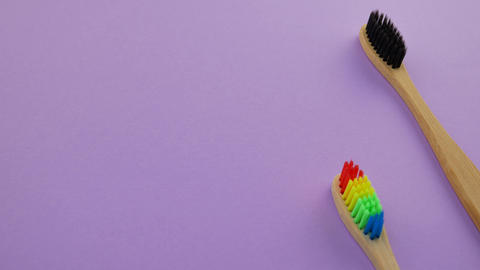 Black white and rainbow bamboo toothbrushes Live Action