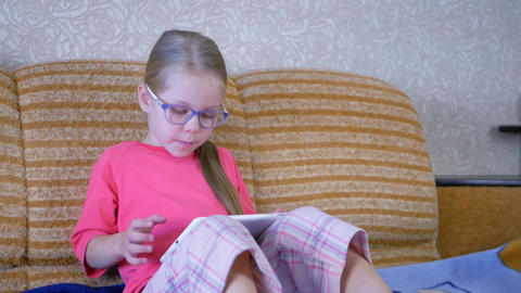 Little girl with digital tablet PC GIF