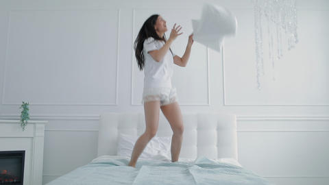 Joyful Girl Dancing on Bed with Pillow Live Action