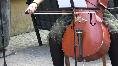 Vilnius, Lithuania – May 2017: annual street music day. Lonely musician playing classical music with Live Action