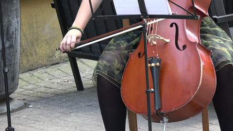 Annual Vilnius street music day. Musician hands playing classical music with double-bass in Vilnius Live Action