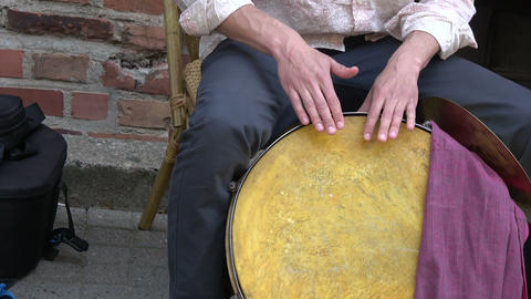 Musician drummer hands playing with big drum in street Archivo