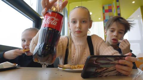 Baltimore, Maryland, USA - February 21, 2019: teenager girl and boy eating fast Footage