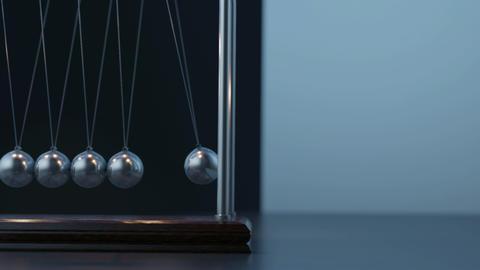 Pemdulum Balls Swinging Newton's Cradle Passing Business Moment Loop closeup Animation