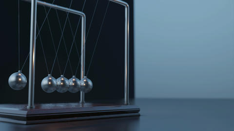 Pemdulum Balls Swinging Newton's Cradle Passing Business Time Loop closeup GIF