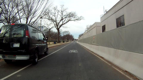 A hanheld shot of driving on a straight road in Washington DC on a cloudy day Footage