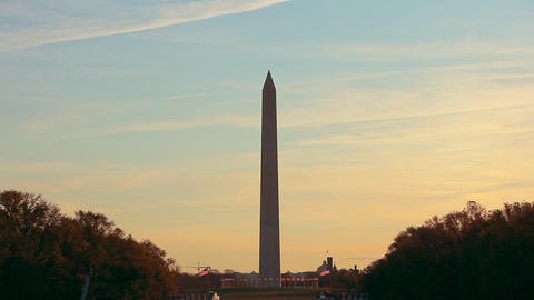A static shot of the Washington Monument at sunset in Washington DC Live Action