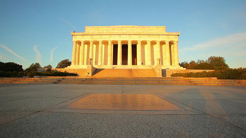 A tracking shot of the exterior of the Lincoln Memorial at dusk in Washington DC Footage