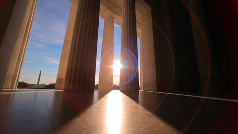 A tracking shot with a lens flare of the bottom of the pillars of the Lincoln Me Footage
