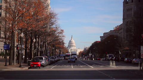 A static shot of a busy road in front of the historic US Capitol building during Footage