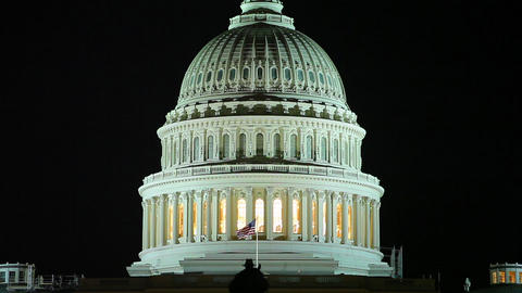 A static shot of the US Capitol at night Footage